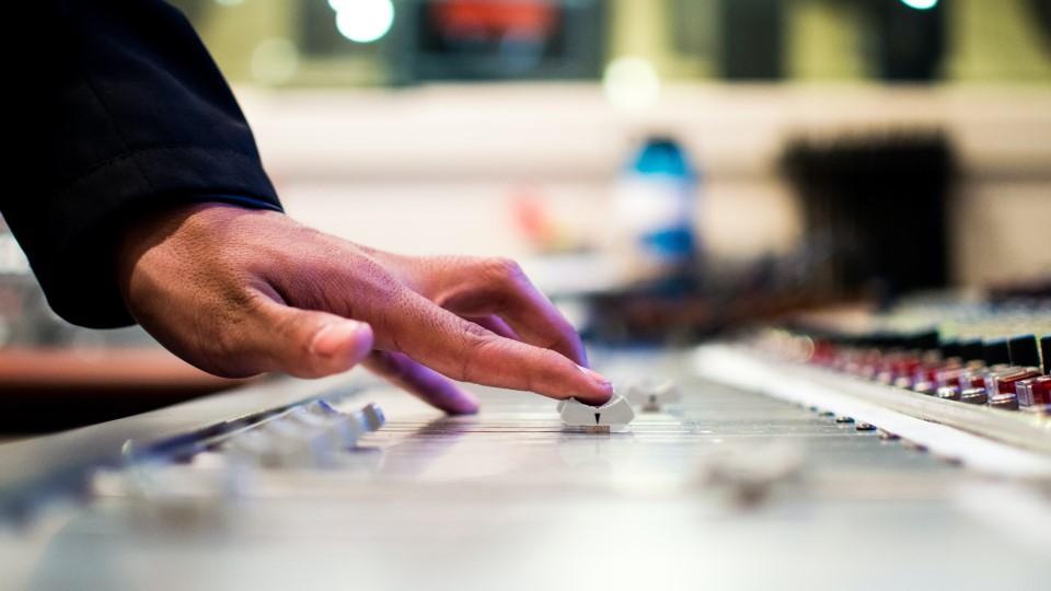 Adjusting mixer settings, photo by Drew Patrick Miller on Unsplash